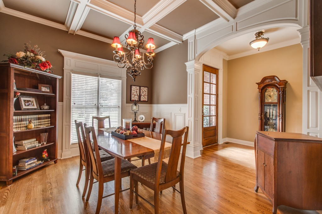 The coffered ceiling adds form and visual balance to the dining room off the front entryway. This cheery room is a wonderful place to spend your family meals.