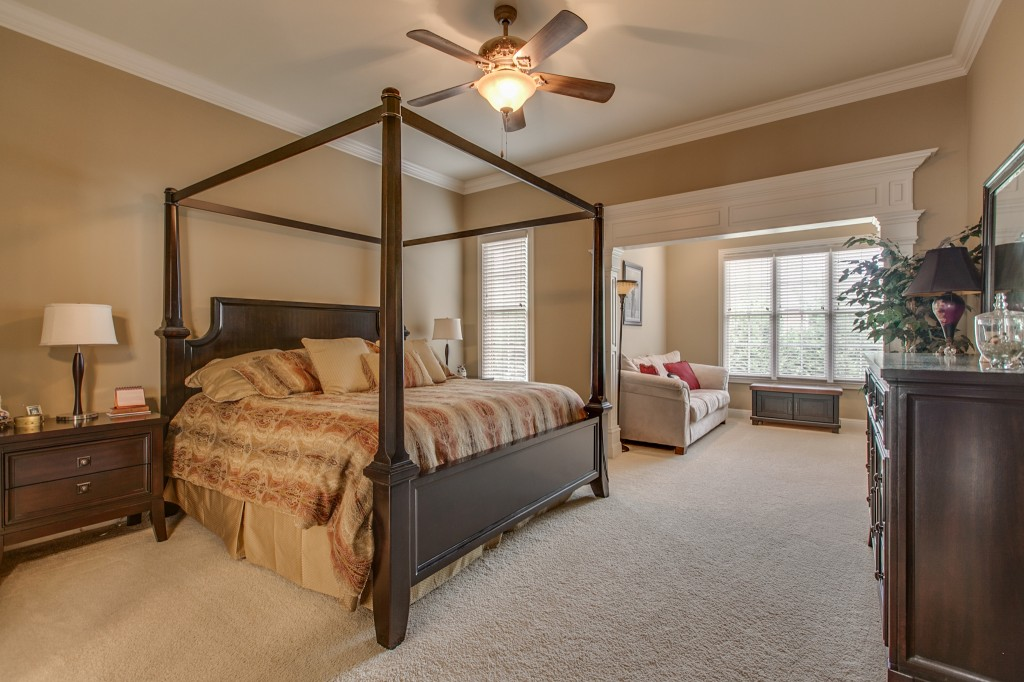 The extra-large master bedroom has an attached sitting room.