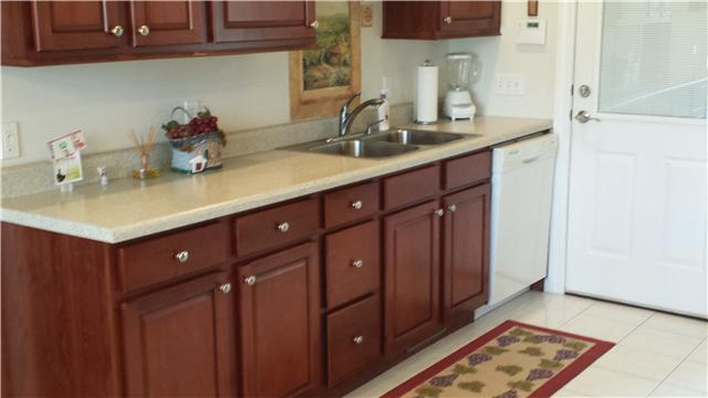 This kitchen includes a microwave, dishwasher and gas oven.