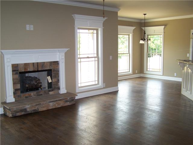 Main living room with lots of light and a lovely fireplace