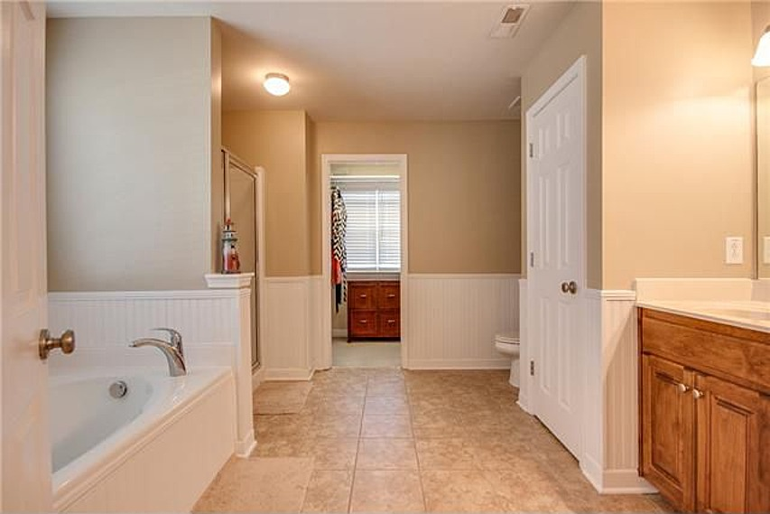 Master Bathroom with separate shower and soaking tub