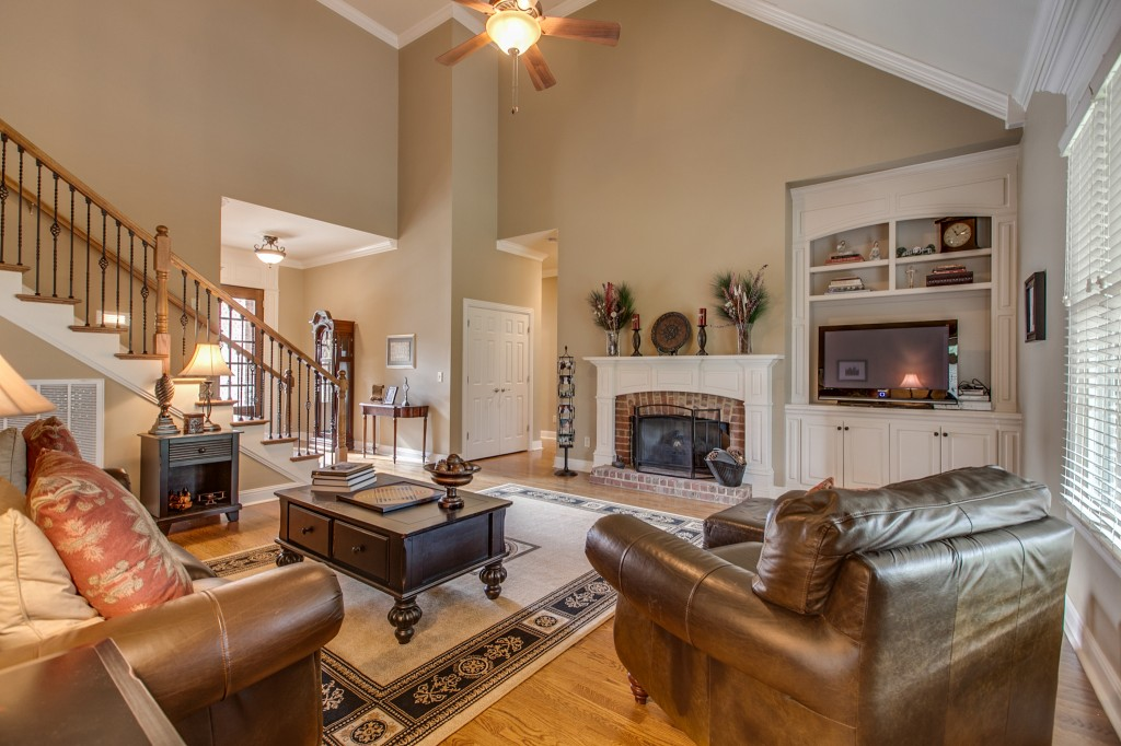 A specious living room with a vaulted ceiling greets you as you walk in the front door.